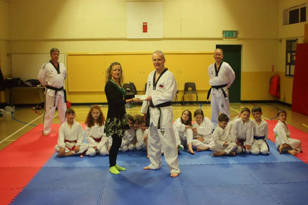 Ms Alison Peters, chair of Alveston Parish Council, with members of Frontline Martial Arts