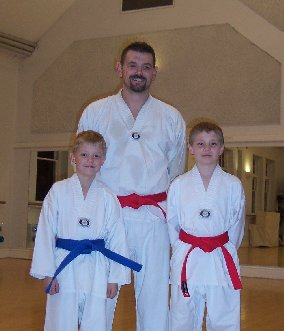 Lewis, Des and Connor after receiving their new belts