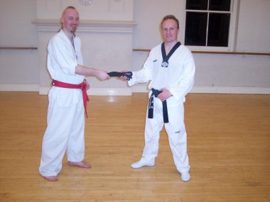 Master Evans presents Mr Tovey with his Black Belt